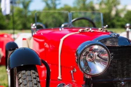 headlight: Close up of head-light of the retro red car Stock Photo