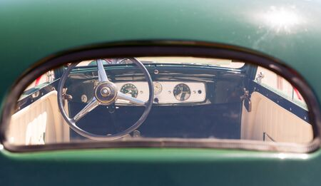 transport interior: View of rudder through the glass of vintage car