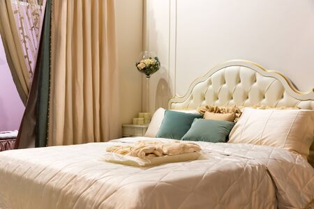 bedroom suite: Vintage bedroom interior. Bed with pillows