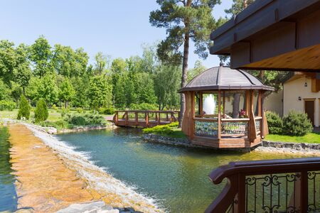 summerhouse: Wooden summer-house on the lake in spring park