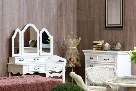 old fashioned: Side view of modern luxury bedroom with refined furniture