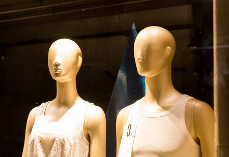 seasonable: Two mannequins in female dresses in the shop Stock Photo
