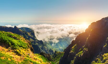 sunny season: Sunny mountains in clouds landscape, Portugal, Madeira Stock Photo