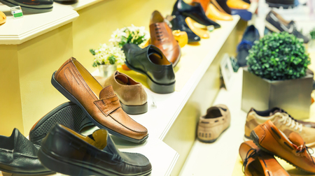 show case: Close up of different mans shoes on the show case Stock Photo