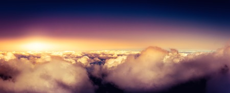 Panorama of clear sky above the clouds and sunset Фото со стока