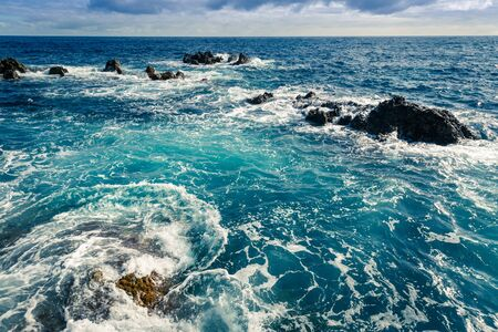 rocks water: Rough ocean with waves and rocks landscape, Portugal, Madeira