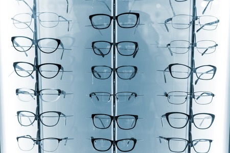 optical: Set of eyeglasses on behind the shop window