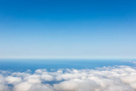 clouds and sky: Aerial view of clear sky above the clouds against ocean