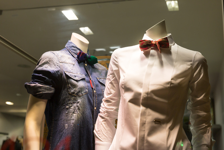seasonable: Two mannequins in male shirts in the shop