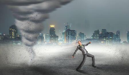 career job: Businesswoman running from the tornado