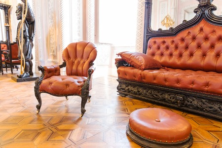 vintage furniture: Room with luxurious vintage leather-covered furniture