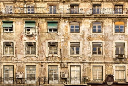 house windows: Old faded european house with wooden windows, Portugal Stock Photo