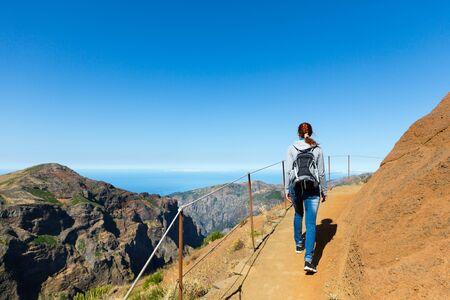 Traveler hiking in beautiful mountains, Portugal, Madeira photo