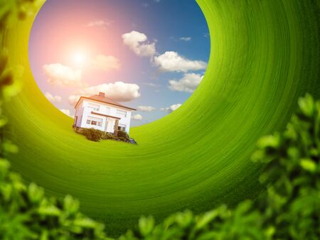 microcosm: Microcosm of single house on the green lawn in rotation