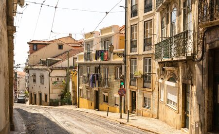dwelling: Narrow street with dwelling houses and tram-lines