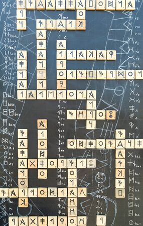 decoding: Hieroglyphes on crossword puzzle against abstract background