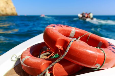 rescue: Close up of life-buoys on the boat in the sea