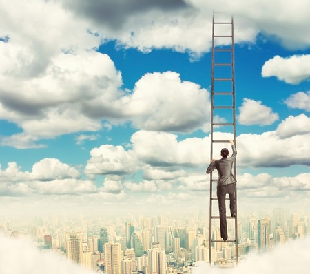 Businesswoman climbing the ladder to the sky