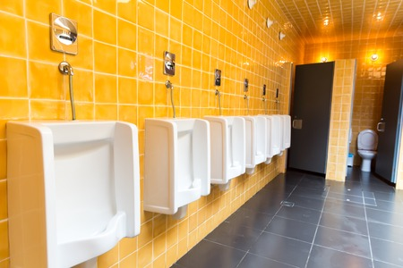 view an elegant wardrobe: Set of urinals the mens public toilet Stock Photo
