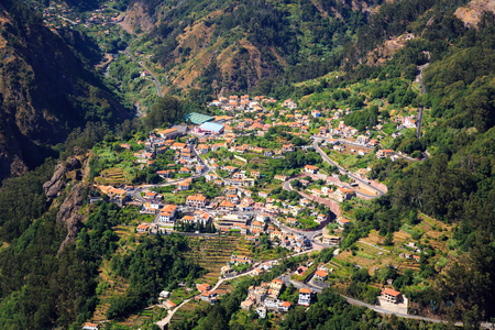 tourist feature: Up view of little city situated in the mountains Stock Photo
