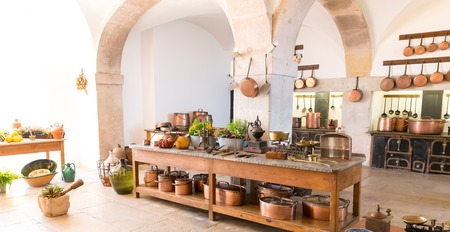 Kitchen interior with old pots and cupboard