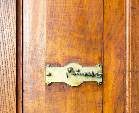 hook up: Close up of wooden cupboard with a hook lock Stock Photo