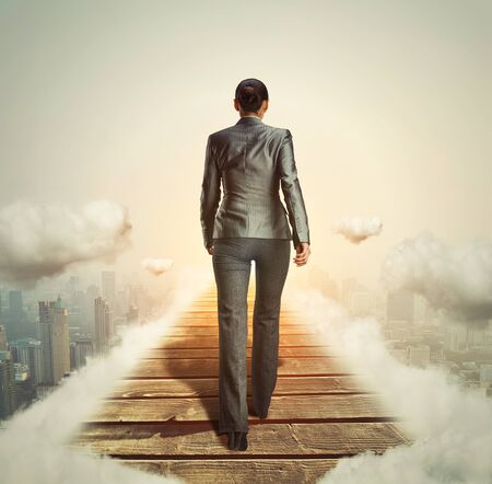 way: Businesswoman walking on her way to the light