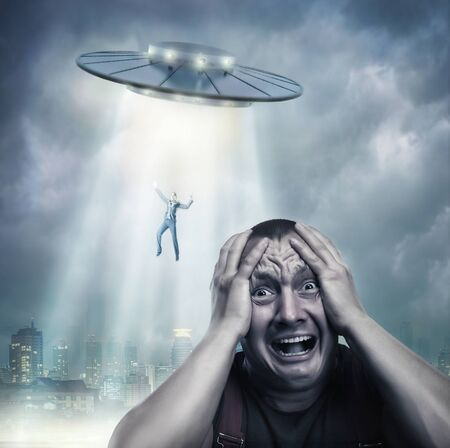 abduct: Scared by UFO man screaming at night Stock Photo