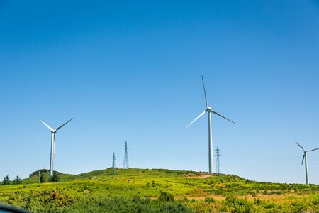 mill valley: Windmills in the green valley against clear sky Stock Photo