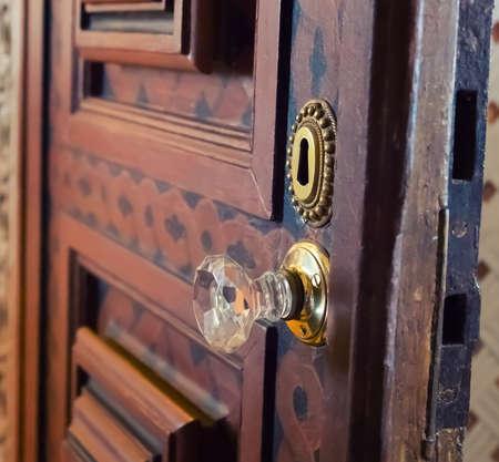 wood carving door: Key hole in wooden door close up Stock Photo