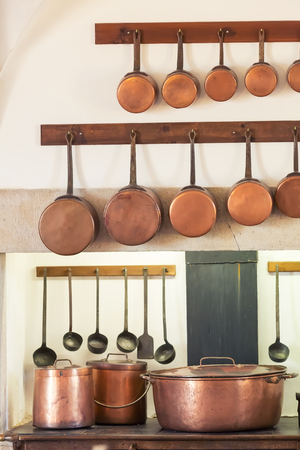 Retro Kitchen Interior With Old Pans, Pot On The Furnace Close Up Photo