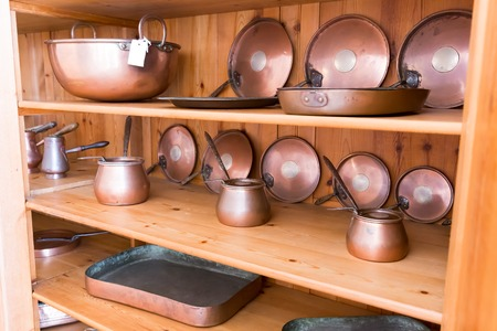 anisetree: Set of old ibriks and pans on the wooden shelf