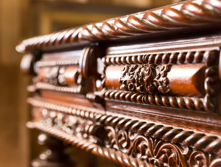 antique table: Luxurious table with wood engraving on the case close up