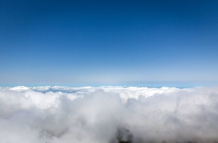 clouds sky: Clear sky above the clouds