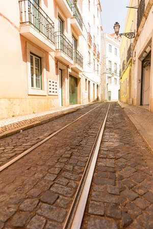 rapid steel: Tram rails on paved road on the narrow street