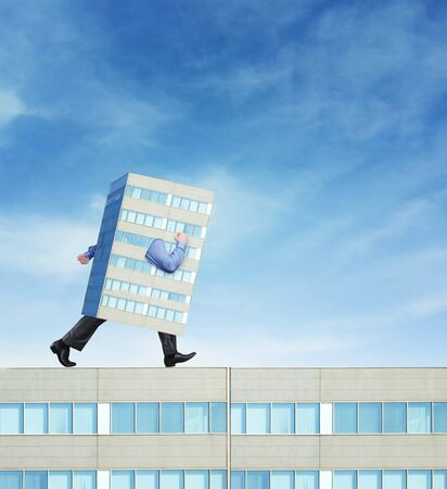 formal wear clothing: Skyscraper as a businessman is going forward Stock Photo