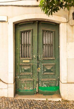 green door: Old green entrance door close up