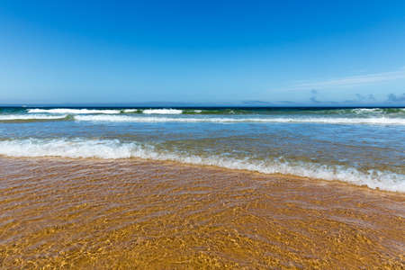 sandy beach: Coastline with waves of the sea on the sandy summer beach, Portugal Stock Photo