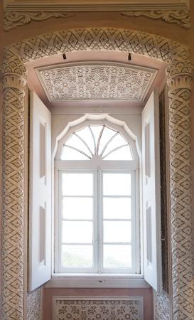 lightrays: Beams of sunlight in the window inside in dark lodging