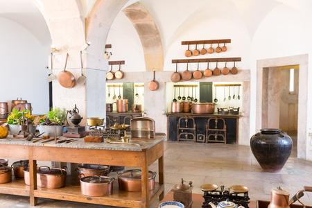 Retro kitchen interior with old brass kitchenware