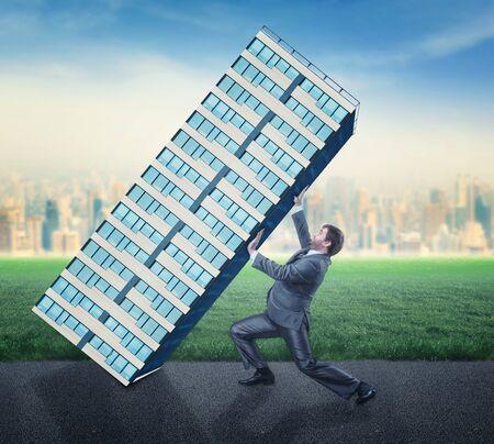 dangerous construction: Businessman taking care of an office building