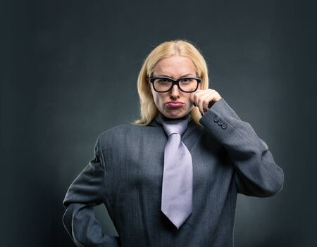 self assurance: Funny nerd businesswoman in glasses over grey background