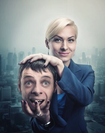 psych: Happy businesswoman with mans head in her hand