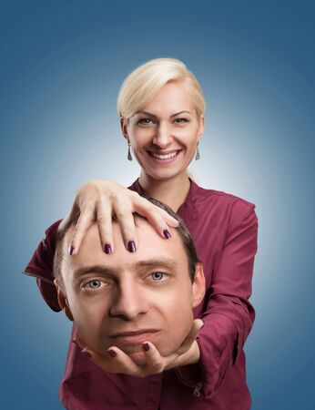 extrasensory: Happy analyst with clients head in her hand