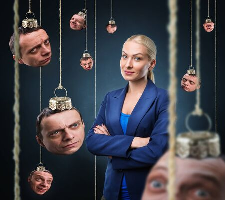 psych: Confident businesswoman with various emotions heads hanging like Christmas balls Stock Photo