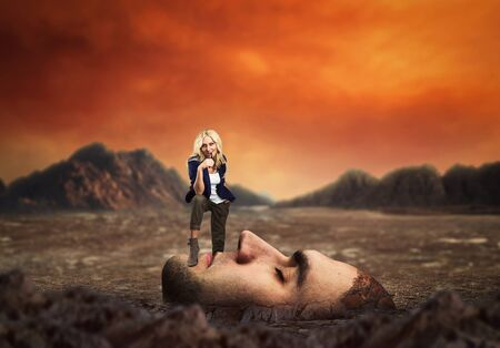psych: Young confident personal coach standing on the clients face in desert