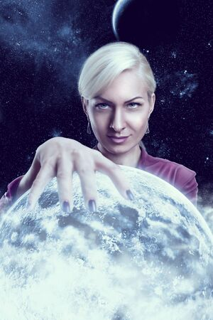 fortuneteller: Mystic fortune teller woman holding a planet ball in the night