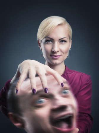 psychic: Psíquica seria con la cabeza estresado en su mano Foto de archivo