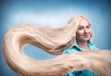 capelli lunghi: Young smiling woman with long blond hair Archivio Fotografico