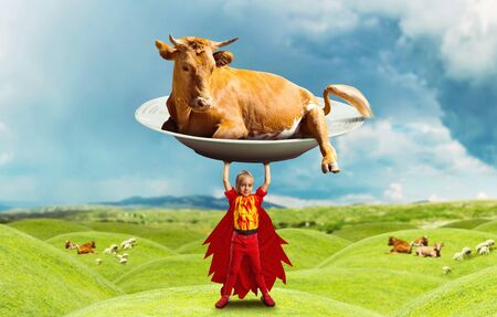 Little girl in costume holding a big cow on the meadow